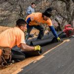 two men installing roof felt - northface construction