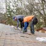 two men installing shingles